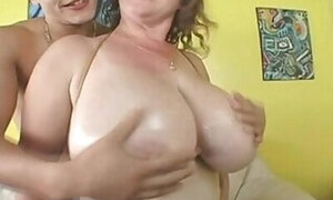 Fat lady with huge tits fucks a much younger guy