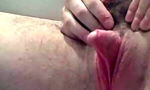 Mature extra hairy wife strokes her  big 2 inch long erect clitoris