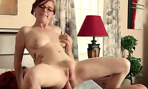 This four eyed redhead loves backdoor sex and she is a big reverse cowgirl fan