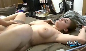 Horny inked guy pounds his busty girlfriend in bed