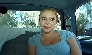 Charming big tits cowgirl replenishing big cock with titjob in the car