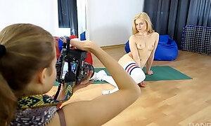 Sporty blonde babe Kyra Yorke poses naked in long football socks