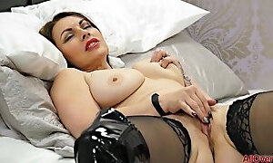 Busty mature lady takes off her clothes to reach her wet pussy