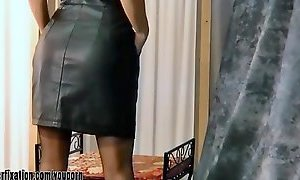 Kinky milf strips off leather dress and reveals her tits and thong