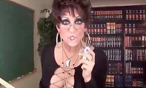 Masculine lady teacher with big cock masturbates