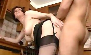 Milf in stockings taken in her kitchen